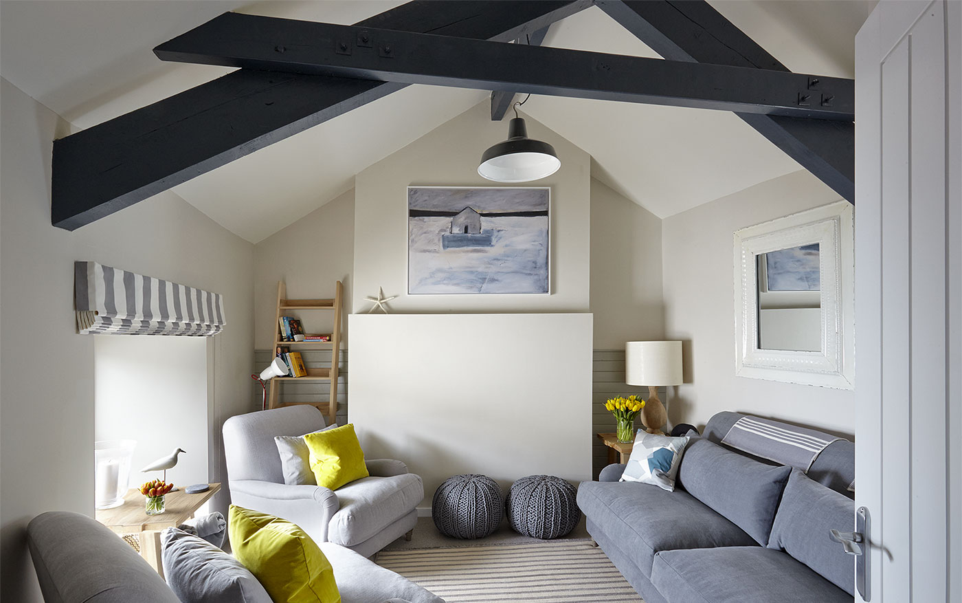 Charming coastal cottage in Porthleven, Cornwall with feature painted beams.
